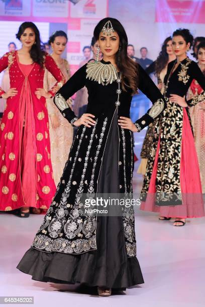 Bollywood actress Sonal Chauhan walk the ramp showcasing the designer collection during the Jaipur Couture Fashion Show in JaipurRajasthan India on...