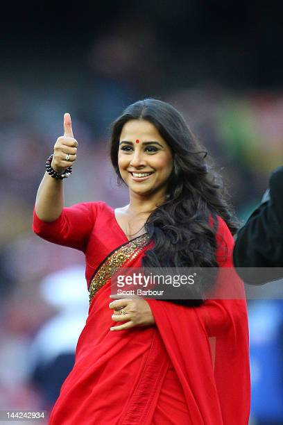 Bollywood actress Vidya Balan gestures after delivering the match ball to the umpires before the round seven AFL match between the Richmond Tigers...