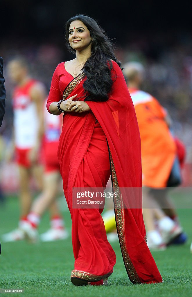 Bollywood actress Vidya Balan looks on after delivering the match ball to the umpires before the round seven AFL match between the Richmond Tigers...