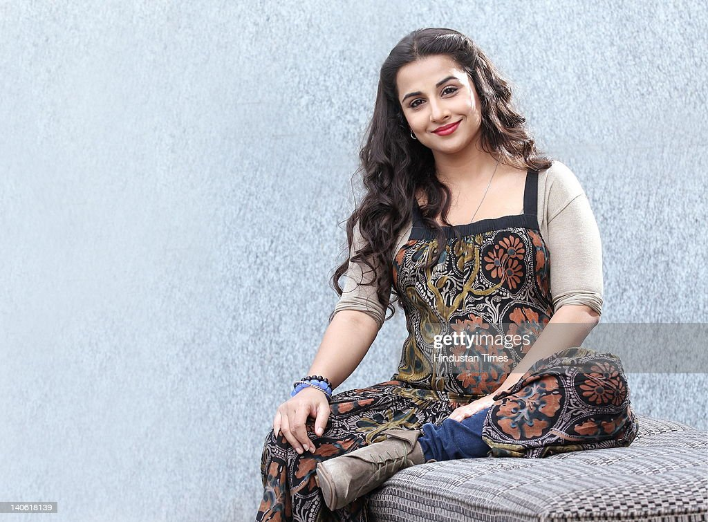 Bollywood actress Vidya Balan poses with her fake baby bump during promotion of her upcoming film 'Kahani' on March 1 2012 in New Delhi India Balan...