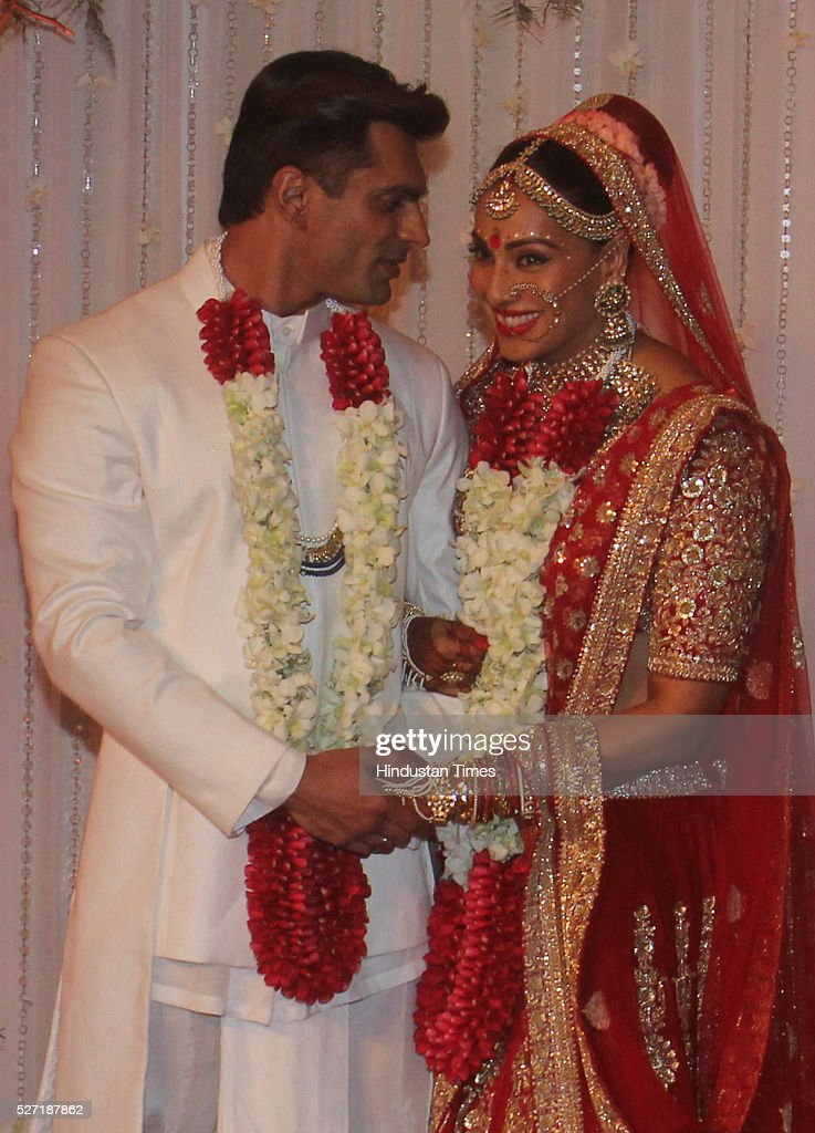 Bollywood actor couple Bipasha Basu and Karan Singh pose for shutterbugs after their wedding ceremony on April 30, 2016 in Mumbai, India. Bipasha Basu got married to Karan Singh Grover in a beautiful traditional Bengali wedding, attended by family and close friends. This is Bipashas first marriage, while Karan has been married twice before to Shraddha Nigam for 10 months and to Jennifer Winget for almost 2 years.