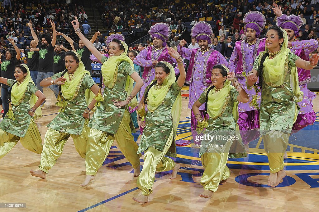 Bollywood dancers preform during a game between the Dallas Mavericks and the Golden State Warriors on April 12, 2012 at Oracle Arena in Oakland, California.