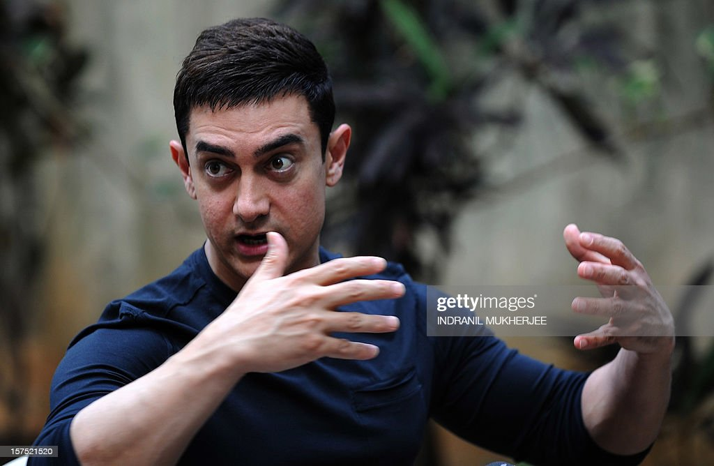Bollywood film actor Aamir Khan gestures during a press conference in Mumbai on December 4, 2012. Khan, dubbed as Indian cinema's Mr Perfectionist returned to the big screen in his first commercial film release for three years, taking up the role of a mustachioed police inspector in a Mumbai crime thriller 'Talaash' (Search). Earlier this year Khan launched a 13-episode Sunday morning television show that won plaudits for tackling some of India's darkest social problems, drawing comparisons between him and US chat show host Oprah Winfrey. AFP PHOTO/INDRANIL MUKHERJEE