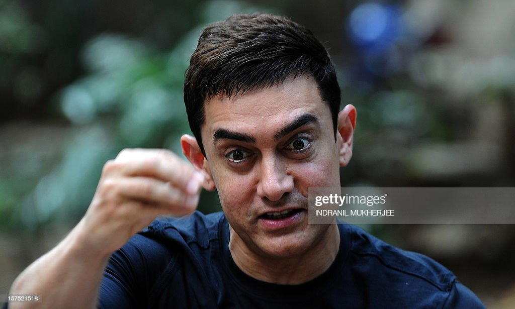 Bollywood film actor Aamir Khan reacts during a press conference in Mumbai on December 4, 2012. Khan, dubbed as Indian cinema's Mr Perfectionist returned to the big screen in his first commercial film release for three years, taking up the role of a mustachioed police inspector in a Mumbai crime thriller 'Talaash' (Search). Earlier this year Khan launched a 13-episode Sunday morning television show that won plaudits for tackling some of India's darkest social problems, drawing comparisons between him and US chat show host Oprah Winfrey.
