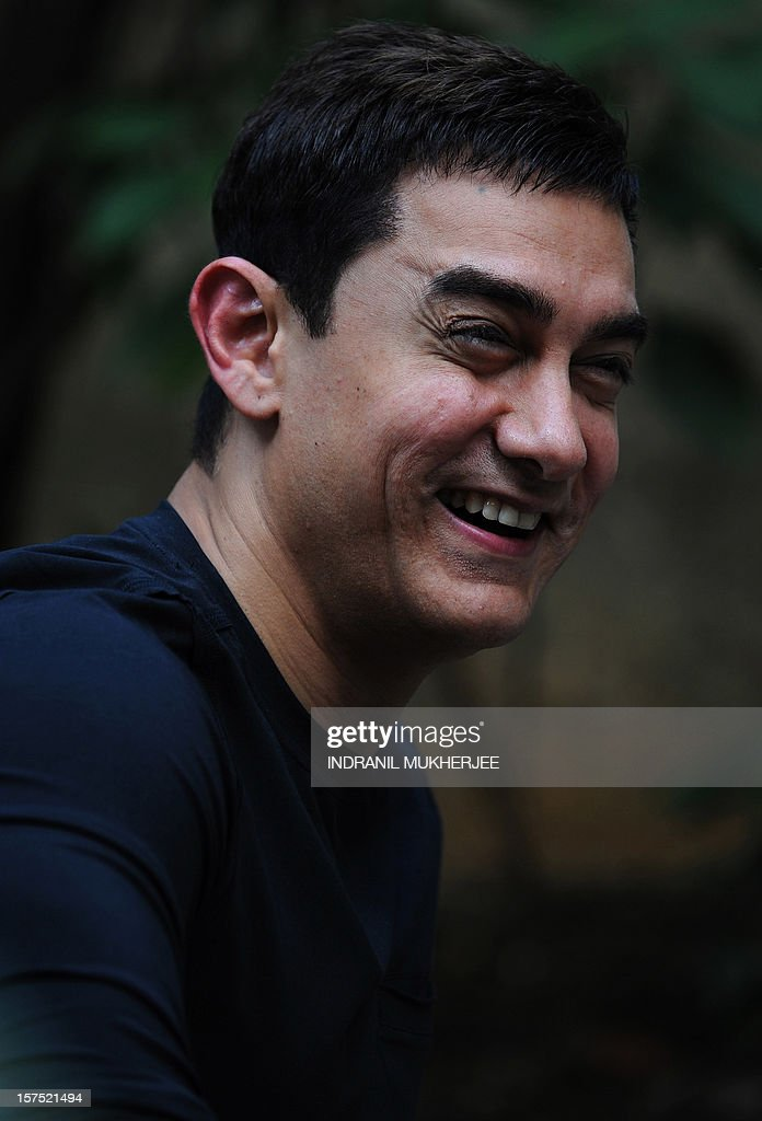 Bollywood film actor Aamir Khan smiles during a press conference in Mumbai on December 4, 2012. Khan, dubbed as Indian cinema's Mr Perfectionist returned to the big screen in his first commercial film release for three years, taking up the role of a mustachioed police inspector in a Mumbai crime thriller 'Talaash' (Search). Earlier this year Khan launched a 13-episode Sunday morning television show that won plaudits for tackling some of India's darkest social problems, drawing comparisons between him and US chat show host Oprah Winfrey.