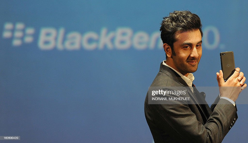 Bollywood film actor and BlackBerry brand ambassador Ranbir Kapoor poses with the BlackBerry Z10 at the country launch of the BlackBerry Z10 in...