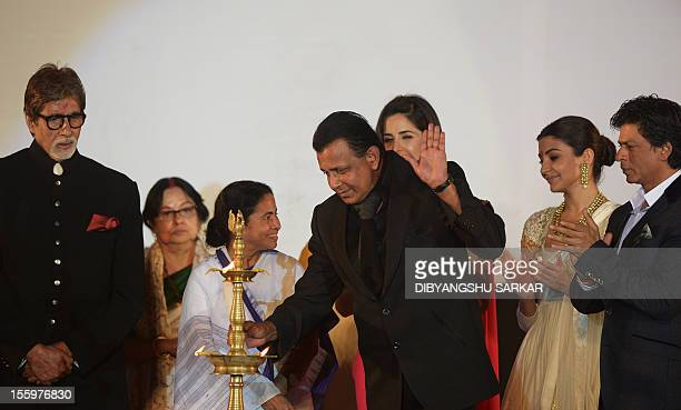 Bollywood film actor Mithun Chakraborty is watched by film actors Amitabh Bachchan Shah Rukh Khan Katrina Kaif and Anushka Sharma and chief minister...