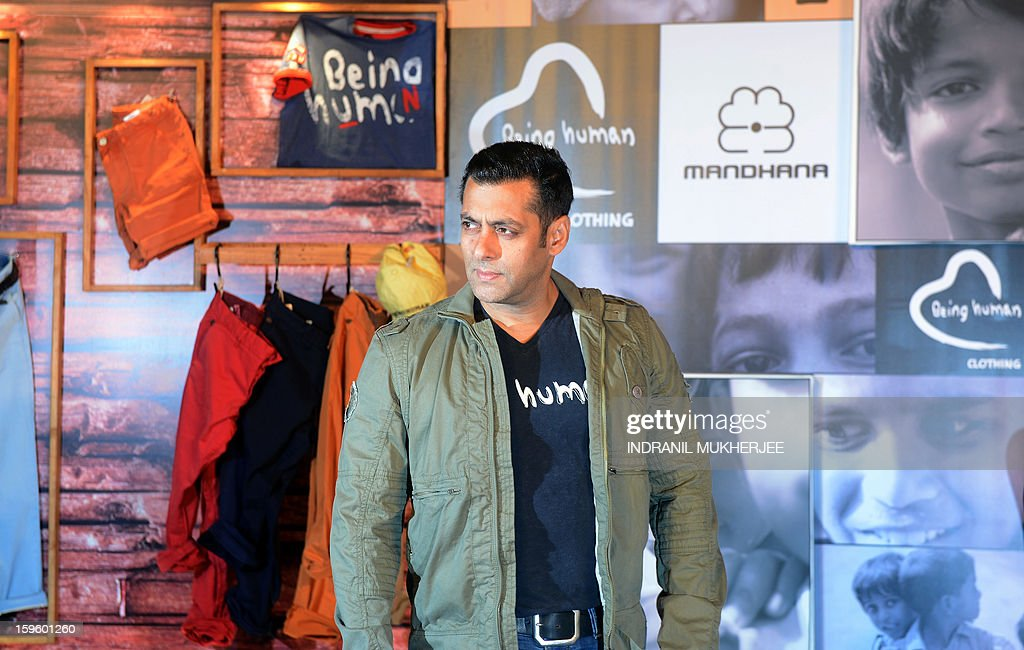 Bollywood film actor Salman Khan poses as he arrives to announce the launch of his 'Being Human' flagship clothing store in Mumbai on January 17, 2013. Khan announced the pan-India launch of his flagship retail store for 'Being Human' fashion apparel after having already launched in Paris, Belgium, Spain and Dubai.