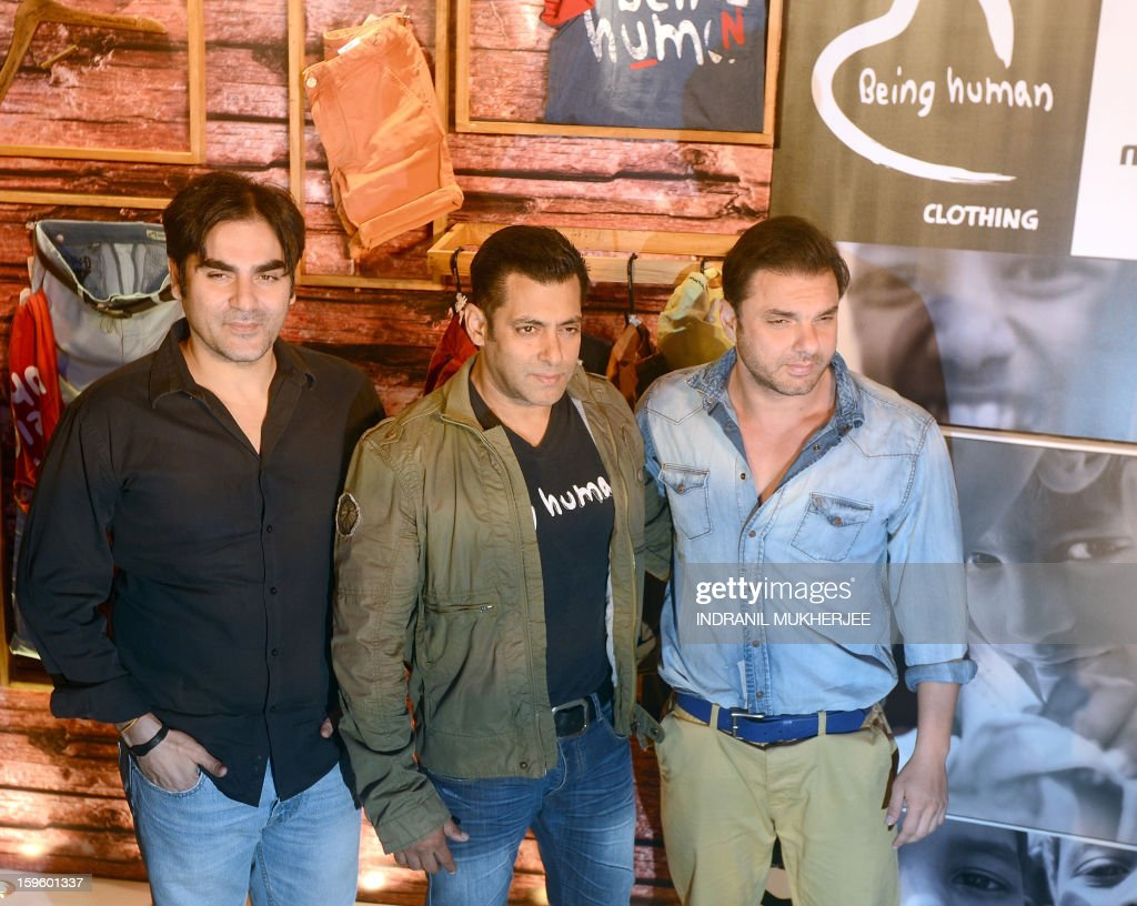 Bollywood film actor Salman Khan (C) poses with siblings Arbaaz Khan (L) and Sohail Khan during the launch of his 'Being Human' flagship clothing store in Mumbai on January 17, 2013. Khan announced the pan-India launch of his flagship retail store for 'Being Human' fashion apparel after having already launched in Paris, Belgium, Spain and Dubai.