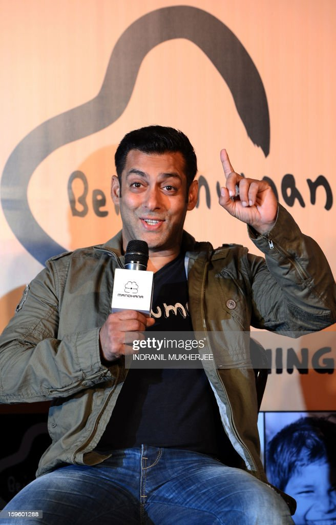 Bollywood film actor Salman Khan smiles during the launch of his 'Being Human' flagship clothing store in Mumbai on January 17, 2013. Khan announced the pan-India launch of his flagship retail store for 'Being Human' fashion apparel after having already launched in Paris, Belgium, Spain and Dubai. AFP PHOTO/ INDRANIL MUKHERJEE