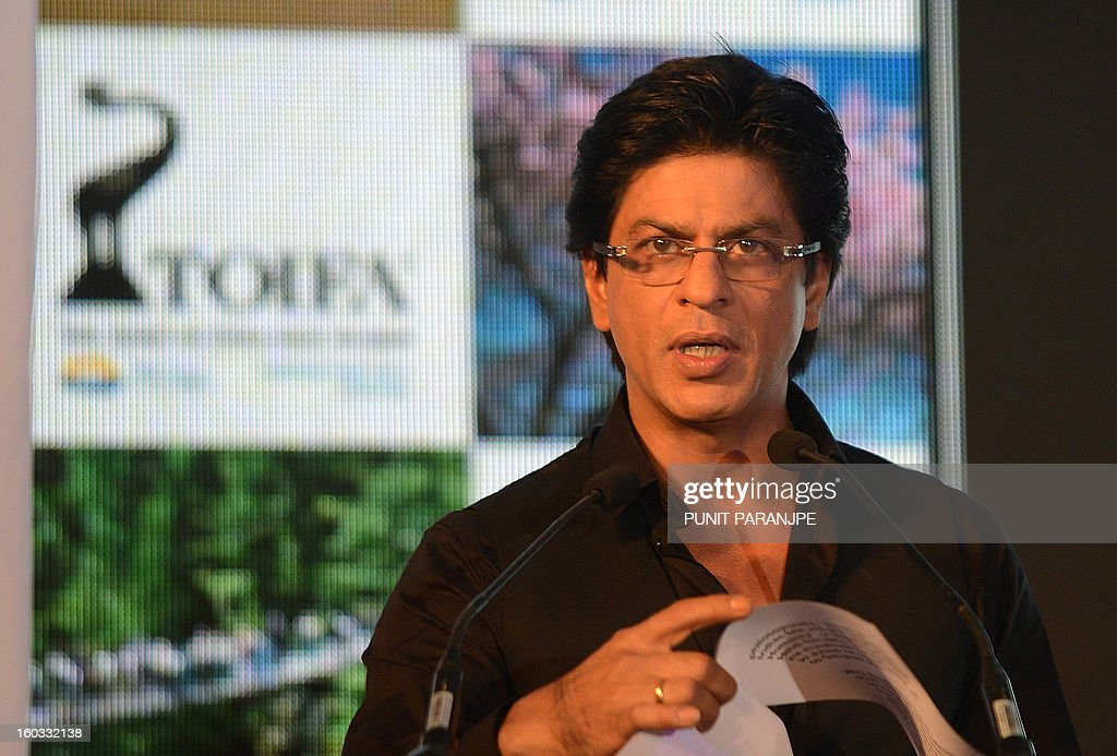 Bollywood film actor Shah Rukh Khan reads out a statement during a function to announce new Times Of India Film Awards (TOIFA) Bollywood awards in Mumbai on January 29, 2013. TOIFA Bollywood awards will take place in Vancouver, Canada from April 4 to 6, 2013.
