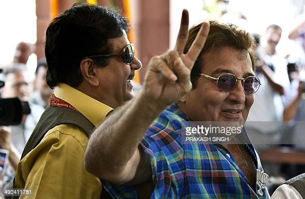 Bollywood film actors and Bhartiya Janta Party leaders Shatroghan Singh and Vinod Khanna pose for the media at Parliament house in New Delhi on May...