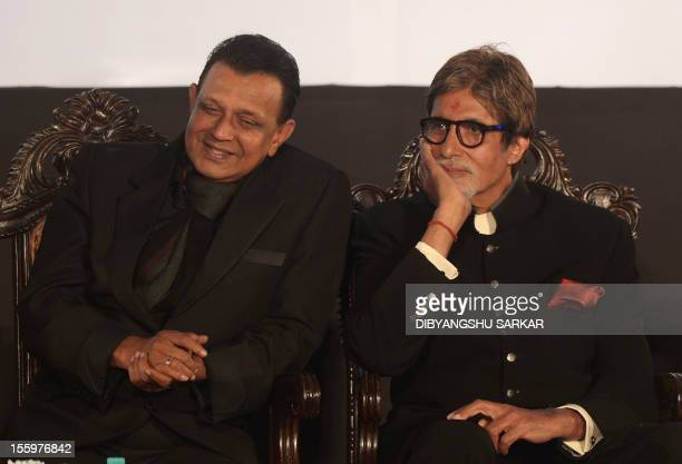 Bollywood film actors Mithun Chakraborty and Amitabh Bachchan attend the inauguration of the 18th Kolkata International Film Festival in Kolkata on...