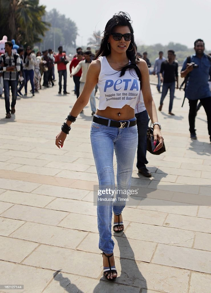 Bollywood film actress and model Sherlyn Chopra leaves after an awareness campaign by People for the Ethical Treatment of Animals (PETA) India for sterilizing dogs on February 19, 2013 in Mumbai, India.