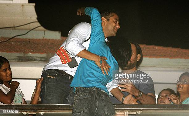 Bollywood film superstar Salman Khan is hugged by a fan on the balcony of his residence at Bandra in Mumbai 13 April 2006 Salman Khan was released on...