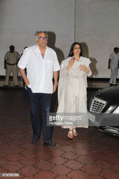Bollywood filmmaker Boney Kapoor with wife Sridevi during the prayer meeting organised for the late Bollywood veteran Vinod Khanna at Worli on May 3...
