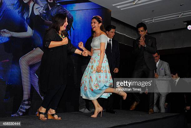 Bollywood filmmaker Farah Khan and actor Deepika Padukone as other costars look on during launch of special video song of film Happy New Year at JW...