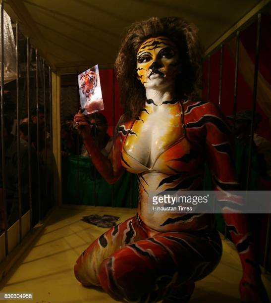 Bollywood Item Girl Rakhi Sawant strikes a pose as a tigress in a cage during a photo call by PETA demanding a ban on use of animals in circus in...