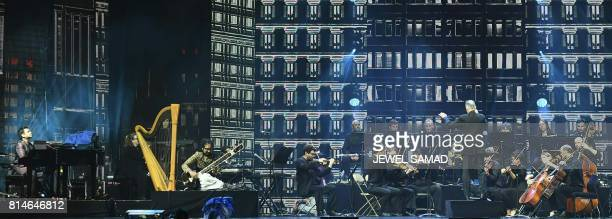 Bollywood music composer and singer AR Rahman performs with a full orchestra at IIFA Rocks July 14 2017 at the MetLife Stadium in East Rutherford New...