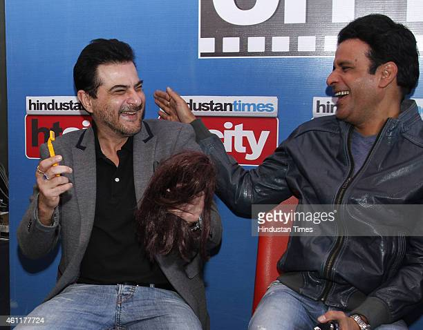Bollywood producer Sanjay Kapoor with actor Manoj Bajpai during an exclusive interview for their upcoming movie Tevar at HT Media Office on January...