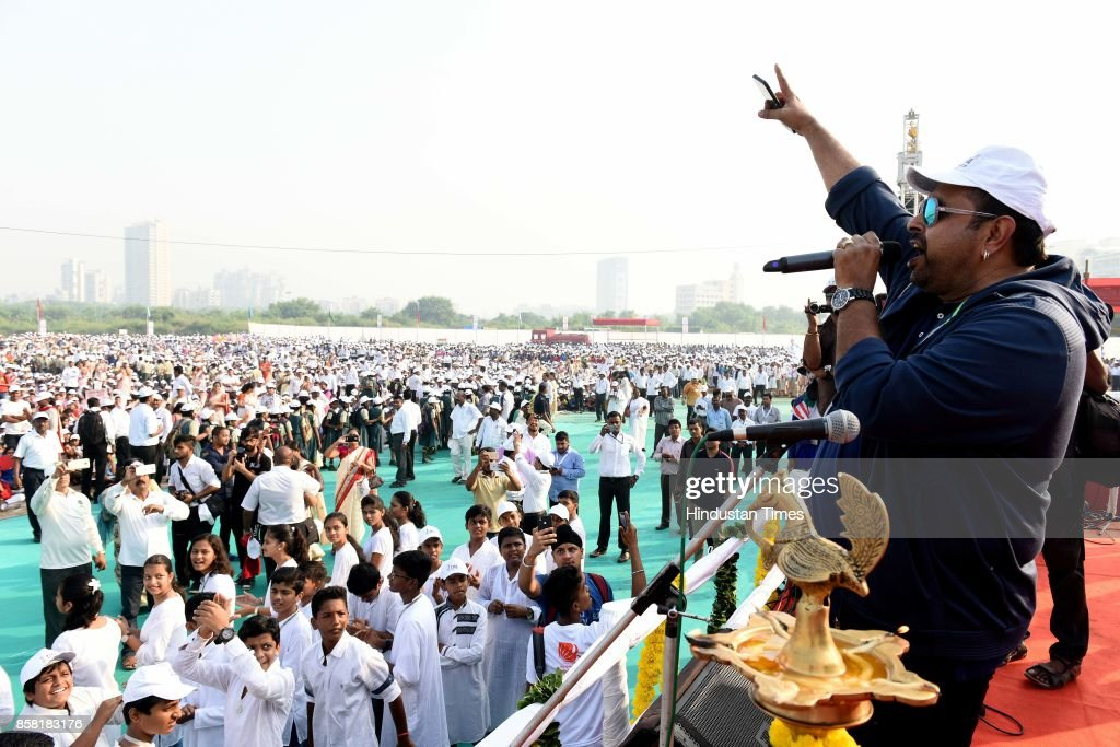 Bollywood singer Shankar Mahadevan and 35,000 students from over 150 educational institutions take part in a 7-km long Walkathon-Cum-Football rally organised by Navi Mumbai Municipal Corporation (NMMC) in view of the FIFA Under-17 World Cup, which kicks off in New Delhi, at Ganpatsheth Tandel Ground Sect 36 Karawe Nerul, on October 5, 2017 in Mumbai, India.