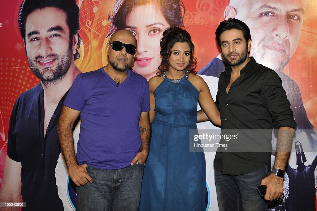 Bollywood singers Shreya Ghoshal, Vishal Dadlani and Shekhar Ravjiani pose for the photographs before interacting with media after the auditions of the Indian Idol Junior at Expo Centre Sector 62 on April 3, 2013 in Noida, India. The awesome trio were thrilled by the phenomenal response to the audition. Enthusiastic people were seen queuing up for their claim to fame from the wee hours of the morning.