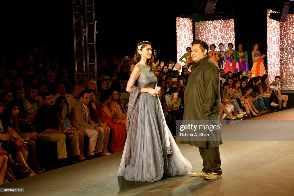 Bollywood star, <a gi-track='captionPersonalityLinkClicked' href=/galleries/search?phrase=Aditi+Rao+Hydari&family=editorial&specificpeople=7435722 ng-click='$event.stopPropagation()'>Aditi Rao Hydari</a> takes a bow with Kolkata-based designer, Debarun, who showcased his debut couture collection, a modern interpretation of Bollywood styles though the decades, on day four of the Fashion Design Council of India's (FDCI) Amazon India Couture Week 2015 on August 1, 2015 at the Taj Palace Hotel in New Delhi, India.