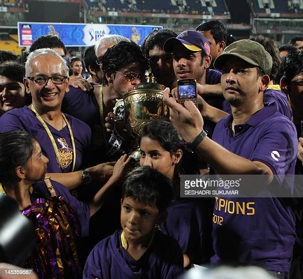 Bollywood star and coowner of Kolkata Knight Riders Shah Rukh Khan the DLF IPL 2012 cup after his team won the IPL Twenty20 cricket final match...