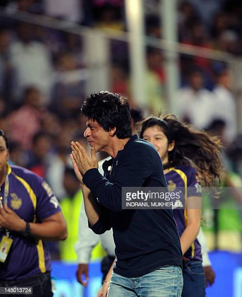 Bollywood star and coowner of Kolkata Knight Riders Shahrukh Khan greets the crowd as he celebrates after his team won the IPL Twenty20 first playoff...