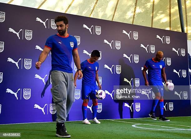 Bollywood star and coowner of the Mumbai City FC team Ranbir Kapoor with Indian striker Sunil Chhetri and French footballer Nicolas Anelka at the...