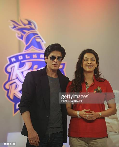 Bollywood star and team owner of Kolkata Knight Riders Shah Rukh Khan and actress Juhi Chawla pose during a news conference to announce the team's...