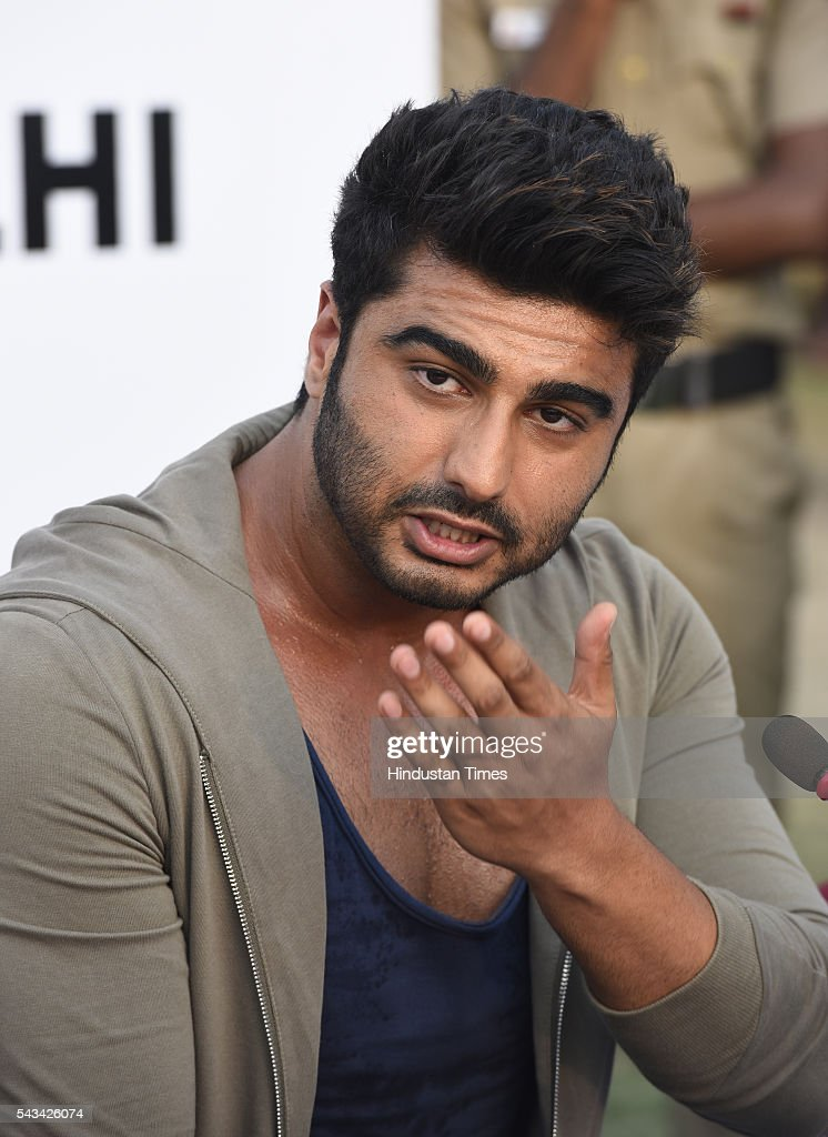 Bollywood star Arjun Kapoor addresses the media during the Road Safety Awareness Campaign at India Gate on June 28, 2016 in New Delhi, India.