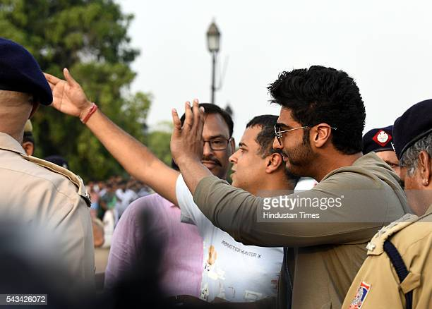 Bollywood star Arjun Kapoor and writer Chetan Bhagat seen with Delhi Police Traffic Official during the Road Safety Awareness Campaign at India Gate...