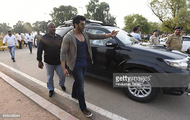 Bollywood star Arjun Kapoor arrives during the Road Safety Awareness Campaign at India Gate on June 28 2016 in New Delhi India