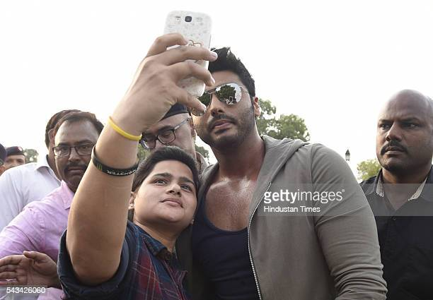 Bollywood star Arjun Kapoor seen taking a selfie with a fan during the Road Safety Awareness Campaign at India Gate on June 28 2016 in New Delhi India