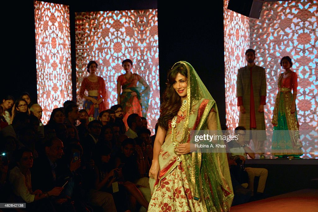 Bollywood star, Chitrangada Singh models Kolkata-based designer, Debarun, who showcased his debut couture collection, a modern interpretation of Bollywood styles though the decades, on day four of the Fashion Design Council of India's (FDCI) Amazon India Couture Week 2015 on August 1, 2015 at the Taj Palace Hotel in New Delhi, India.
