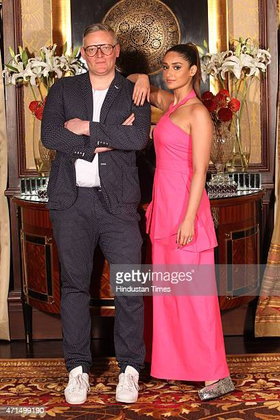 Bollywood star Illeana Dcruz with British designer Giles Deacon pose for the picture at the launch of Giles At Koovs on April 23 2015 in New Delhi...