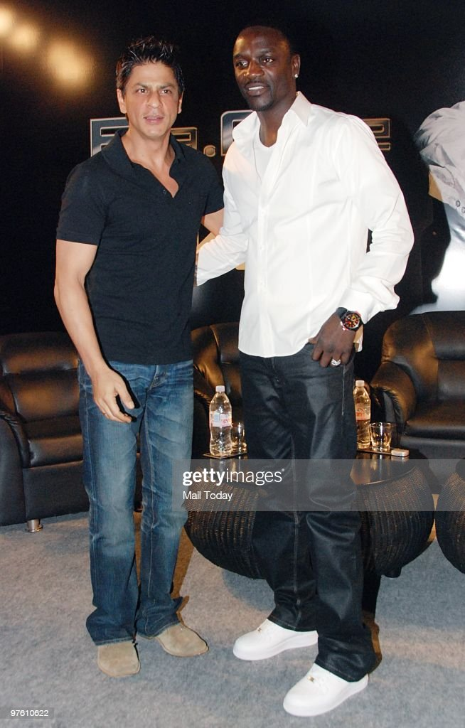 Bollywood star <a gi-track='captionPersonalityLinkClicked' href=/galleries/search?phrase=Shah+Rukh+Khan&family=editorial&specificpeople=664337 ng-click='$event.stopPropagation()'>Shah Rukh Khan</a> and singer Akon pose at a news conference for their forthcoming movie 'Ra.One' in Mumbai March 9, 2010.