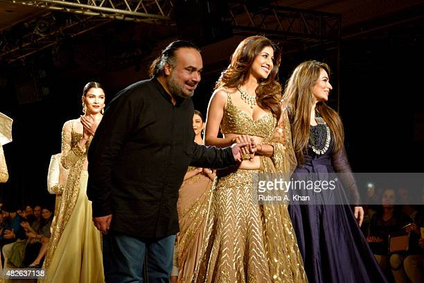 Bollywood star Shilpa Shetty models for Rimple and Harpreet Narula's couture line inspired by the erstwhile days of the Indian Maharajahs at the...