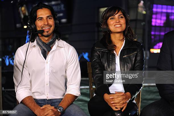 Bollywood Stars Dino Morea and Lara Dutta participate in an interview before the game between the Sacramento Kings and the Los Angeles Lakers at...