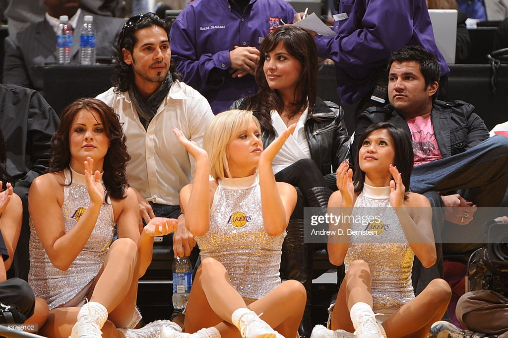 Bollywood stars Dino Morea and Lara Dutta watch the game from courtside between the Sacramento Kings and the Los Angeles Lakers at Staples Center on...