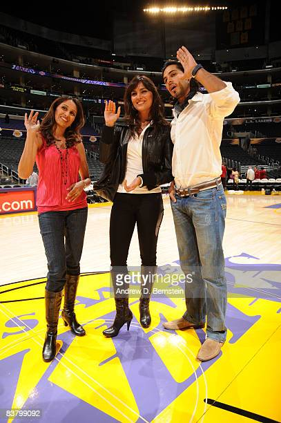 Bollywood Stars Lara Dutta and Dino Morea stand at midcourt following the game between the Sacramento Kings and the Los Angeles Lakers at Staples...
