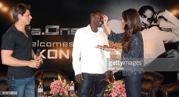 Bollywood stars Shah Rukh Khan Kareena Kapoor and singer Akon at a news conference for their forthcoming movie 'RaOne' in Mumbai March 9 2010