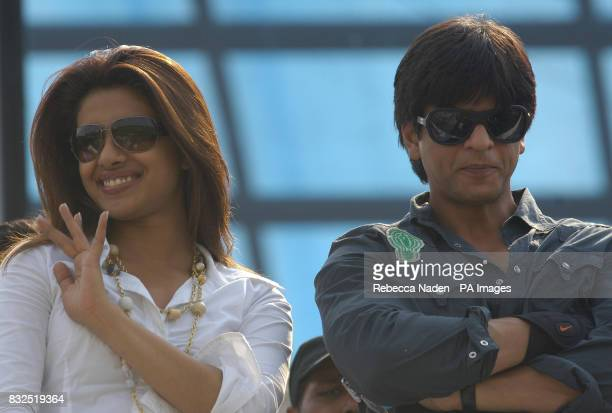 Bollywood superstar Priyanka Chopra and Shahrukh Khan greet the crowd ahead of the ICC Champions Trophy match between India and England at Sawai...