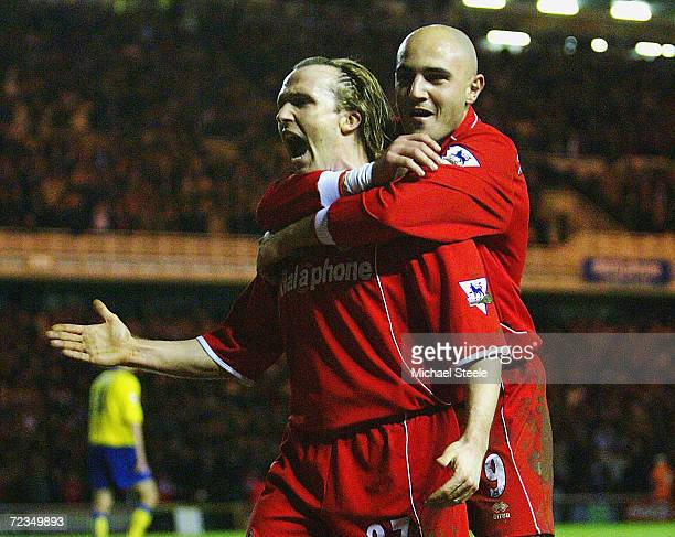 Bolo Zenden of Middlesbrough celebrates with Massimo Maccarone after scoring the first goal during the Carling Cup semi final second leg match...
