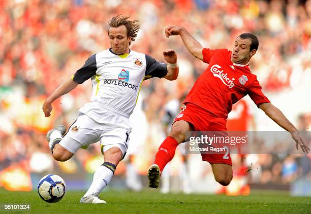 Bolo Zenden of Sunderland is tackled by Javier Mascherano of Liverpool during the Barclays Premier League match between Liverpool and Sunderland at...