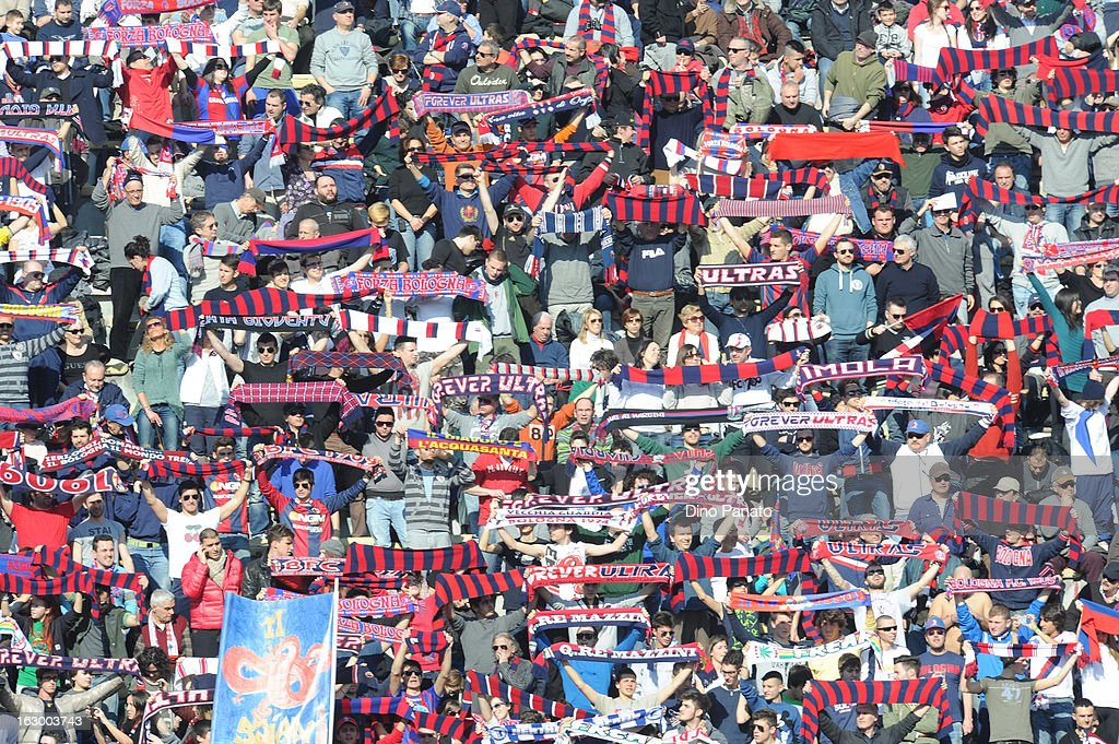 Bologna FC fans hold their team scarves aloft as they show their support during the Serie A match between Bologna FC and Cagliari Calcio at Stadio Renato Dall'Ara on March 3, 2013 in Bologna, Italy.