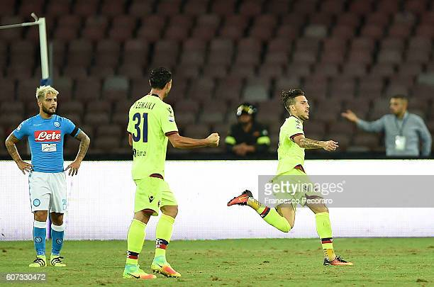 Bologna FC player Simone Verdi celebrates after scoring the 11 goal beside the disappointment of Lorenzo Insigne of Napoli during the Serie A match...
