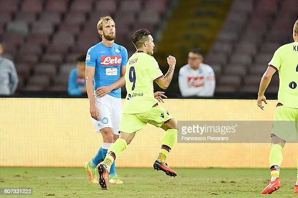 Bologna FC player Simone Verdi celebrates after scoring the 11 goal beside the disappointment of Ivan Strinic of Napoli during the Serie A match...
