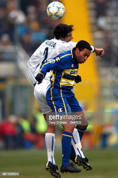 Bologna's Cristian Zaccardo wins the header above Parma's Jenilson Junior